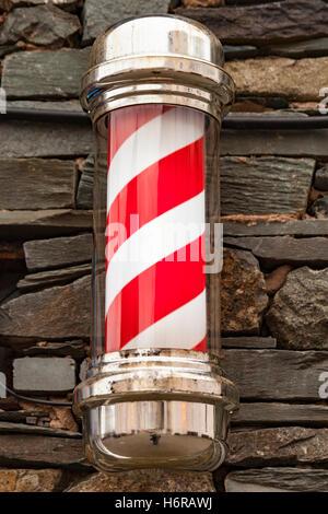 Barber's pole, barber's shop sign, Keswick, Lake District, Cumbria, England - Stock Photo