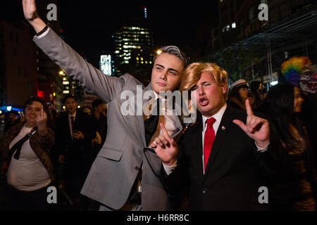 New York, NY - 31 October 2016. Two men costumed as Mike Pence and Donald Trump march in the annual Greenwich Village - Stock Photo