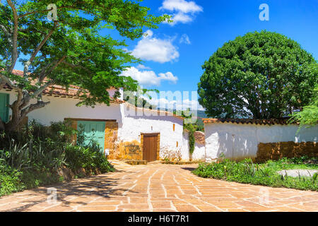Trees and colonial architecture in historic Barichara, Colombia - Stock Photo