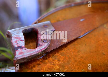tool isolated antique teeth steel rusty rust rusted handle saw farm cut mill blade dark apart circular slice old - Stock Photo