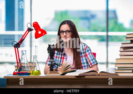Female student preparing for chemistry exams - Stock Photo