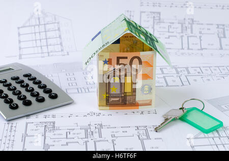 Project planning construction plan with pocket calculator for House build calculator
