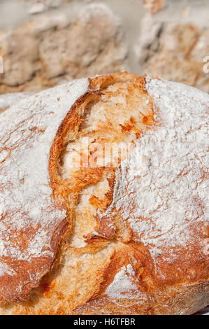 Close up of French crusty bread or Farmhouse Loaf - Stock Photo