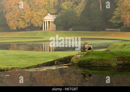 reflections of statues at Studley Royal Gardens - Stock Photo