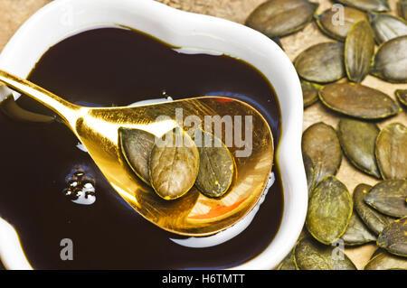 pumpkin seed oil and pumpkin seeds - Stock Photo