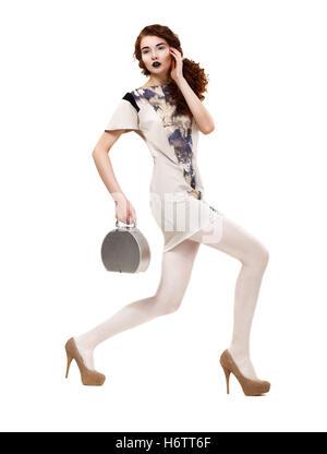 woman profile handbag blue motion postponement moving movement walk go going walking beautiful beauteously nice - Stock Photo