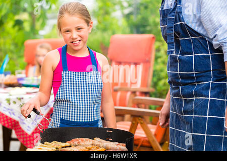cookout with family in the garden in front of house - Stock Photo