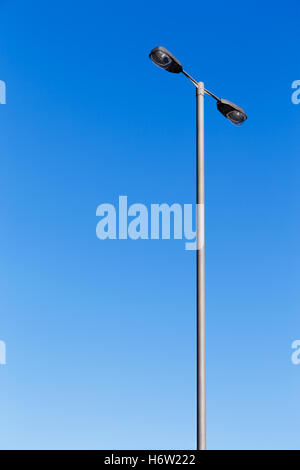 blue shine shines bright lucent light serene luminous sunny energy power electricity electric power lamppost metal - Stock Photo