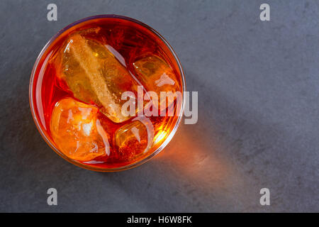 restaurant cup bar tavern glass chalice tumbler orange detail drink drinking bibs liquid closeup black swarthy jetblack - Stock Photo
