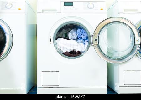 wash washing dirty washing machine laundry washhouse laundrette service public purify wash washing dirty washing - Stock Photo