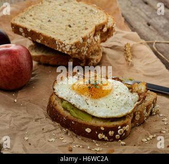 bread spice egg sandwich slice fried avocado food aliment bread spice closeup fruit wheat egg sandwich wooden sliced - Stock Photo