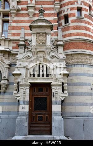 house building stone sculpture goal passage gate archgway gantry entrance door facade house building city town art - Stock Photo