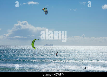 Francois Colussi and Sophie Mathews kitesurfing off Keel beach, Achill Island, County Mayo, Ireland. - Stock Photo