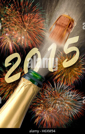 champagne and fireworks at new year 2015 - Stock Photo