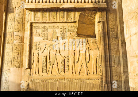 The relief depicts the ceremony of Pharaoh coronation in presence crocodile-headed god Sobek, Kom Ombo Temple, Egypt. - Stock Photo