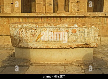 The ruins of the sacrificial table, decorated with the ancient hieroglyphs in Hatshepsut Temple, Luxor, Egypt. - Stock Photo