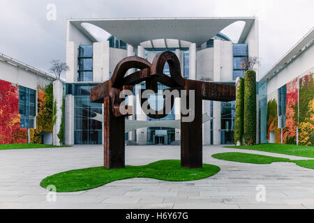Berlin, Germany. Bundeskanzleramt German Chancellery, Chancellor's office building and rusty re-unification sculpture - Stock Photo