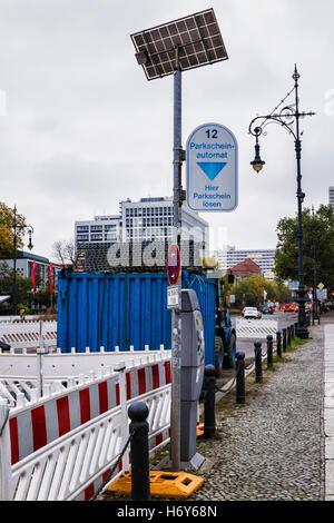 Solar powered parking meter, ticket machine. Urban green energy. - Stock Photo