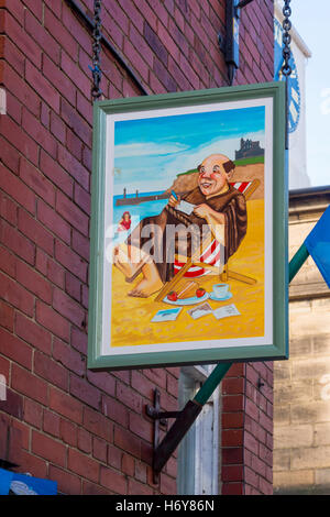 Sign of the Monk's Haven Café Brasserie in Church Street Whitby - Stock Photo