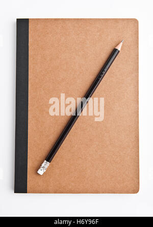 Brown note book empty and blank with pencil on white background - Stock Photo