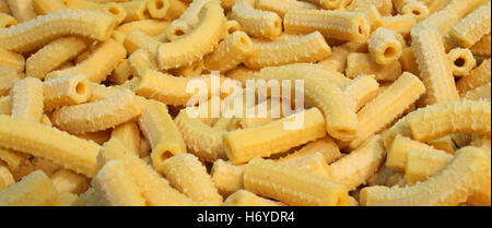 yellow macaroni dry fresh pasta with eggs made in Italy - Stock Photo