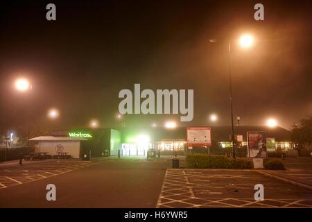 empty welcome break motorway service station at night in fog United Kingdom