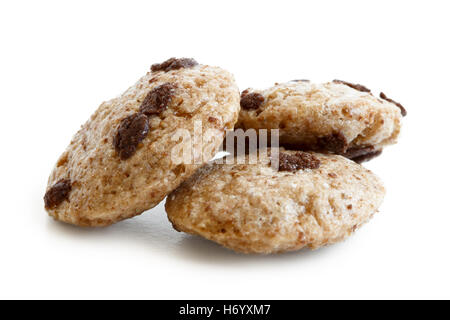 Three chocolate chip cookies cereal isolated on white. - Stock Photo