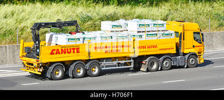 Transportation logistics Canute Building Materials crane off load hgv articulated trailer lorry transporting 'Tarmac' - Stock Photo