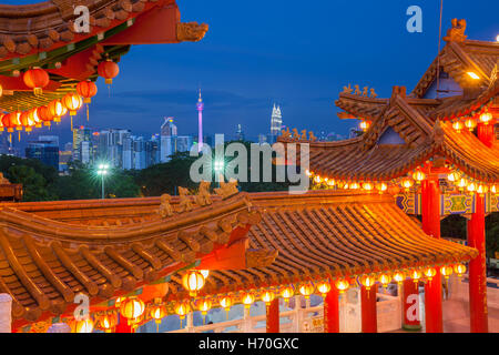 Dusk view of Kuala Lumpur skyline as seen from Thean Hou Temple illuminated for the Mid-Autumn Festival, Malaysia - Stock Photo