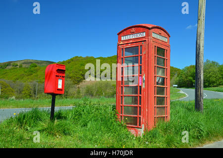 Phone box and post box on the B4358 between Beulah and Llanafan Fawr, Powys, Wales - Stock Photo