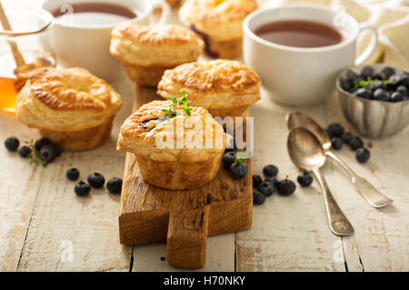 Puff pastries with goat cheese and berry filling - Stock Photo