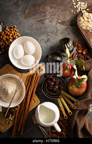 Fall baking concept with apples, oats and flour overhead shot - Stock Photo