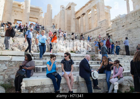 Tourists at the Propylaea, the monumental gateway to the Acropolis of Athens - Stock Photo