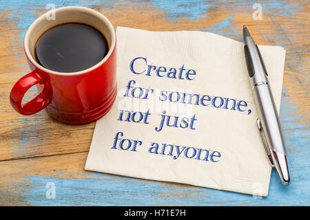 Create for someone, not just anyone - handwriting on a napkin with a cup of coffee - Stock Photo