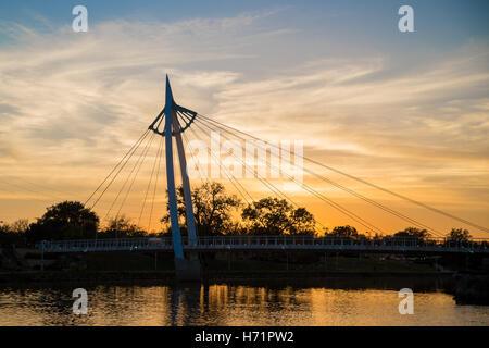 Keeper of the Plains bridge near sunset in Wichita, Kansas - Stock Photo