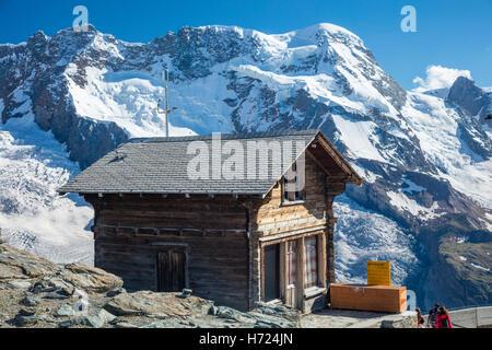 Traditional chalet at Gornergrat beneath Monte Rosa, Zermatt, Pennine Alps, Valais, Switzerland. - Stock Photo