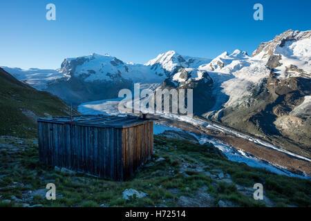 Wooden hut above the Gorner Glacier, Zermatt, Pennine Alps, Valais, Switzerland. - Stock Photo