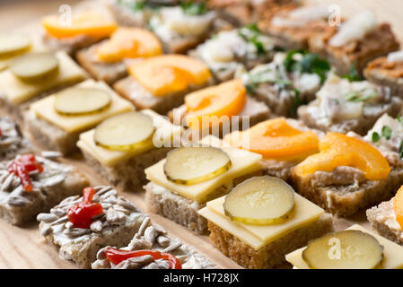 small homemade canapes variety of finger food - Stock Photo