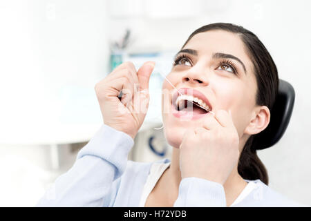 woman health medicinally medical female teeth dentist clinic tooth protect protection latin hygiene equipment treatment - Stock Photo