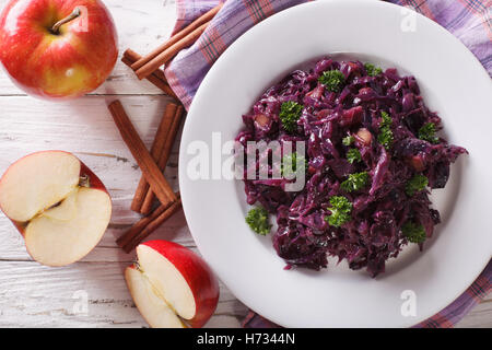 braised red cabbage with apples close up on a plate. Horizontal view from above - Stock Photo