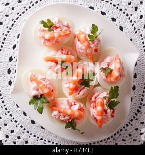 eggs stuffed with prawns and cream cheese close up. view from above - Stock Photo