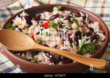 Gallo Pinto: rice with red beans in a bowl close-up on the table. horizontal - Stock Photo