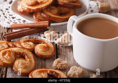 cookies of puff pastry Palmiers and coffee with milk close-up on a table, horizontal - Stock Photo