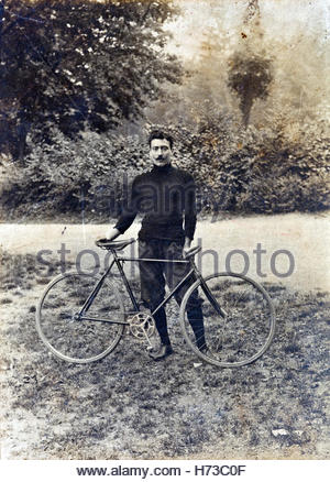 vintage portrait of adult man posing with race bicycle - Stock Photo