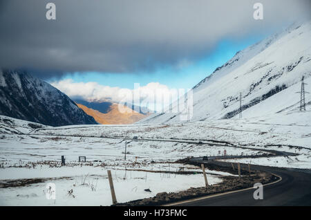 Georgian military road. The scenic winding road among the mountains in Georgia. Main Caucasian Ridge and Cross Pass - Stock Photo