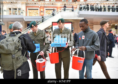 Waterloo Station, London, UK. 3rd November 2016. Armed Forces collecting for the poppy appeal in aid of The Royal - Stock Photo