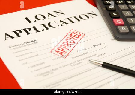 bank lending institution still life application ok closeup calculator horizontal business dealings deal business - Stock Photo