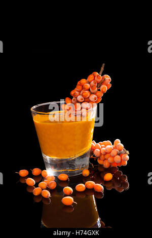 glass chalice tumbler cup orange food aliment detail drink drinking bibs liquid isolated black swarthy jetblack - Stock Photo