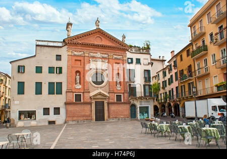 The Church of St. Clement I Pope located on Piazza di Signori, the perfect place to relax in cafe - Stock Photo