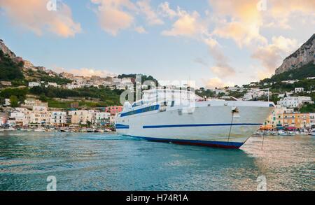 the ship maneuvering in Marina Grande harbour, Capri island, Italy. - Stock Photo